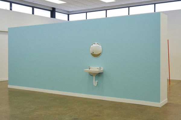 """*Normative Utopia* Neo-colonial """"Edwardian"""" basin and taps, security mirror, Resene """"half-Escape"""" blue wall Severine Costa 2019  *Untitled (pole markers)* 15 powder-coated aluminium tubes 2000 x 25 mm (appx) Xander Dixon 2019  Image: Andreea Christache"""